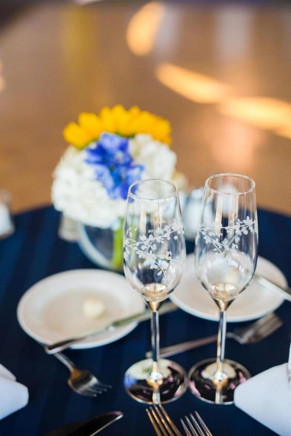 Pier 5 Hotel UTZ and Champagne Glasses and Flower Wedding Shot by Photography by Brea.jpg