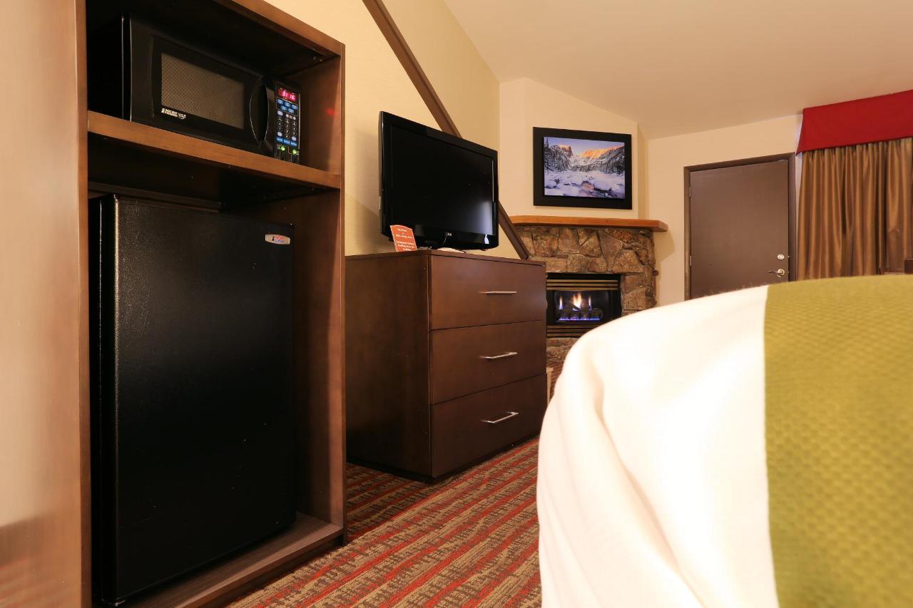 NKQD Frig-TV-Dresser-Fireplace.jpg