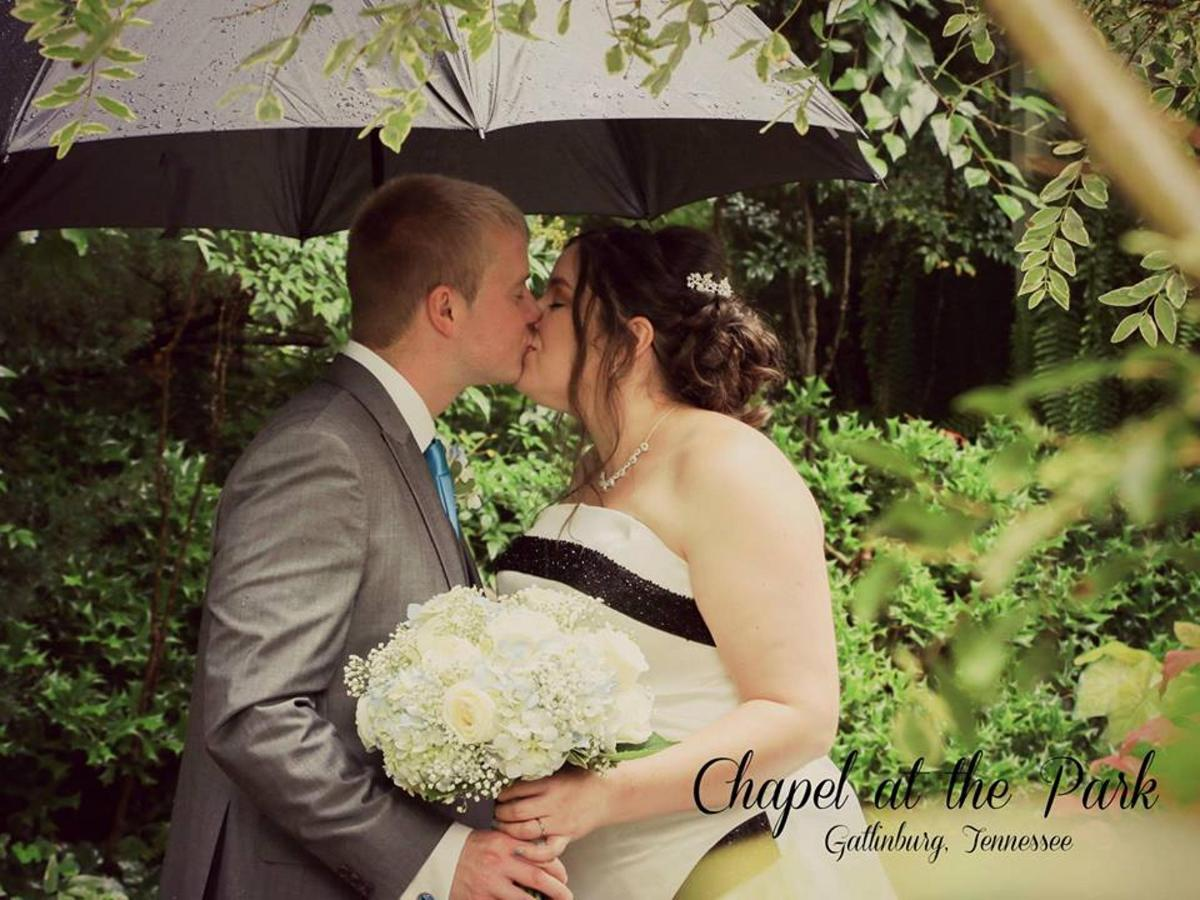 CATP - 2018 Couple under the Umbrella kissing.jpg