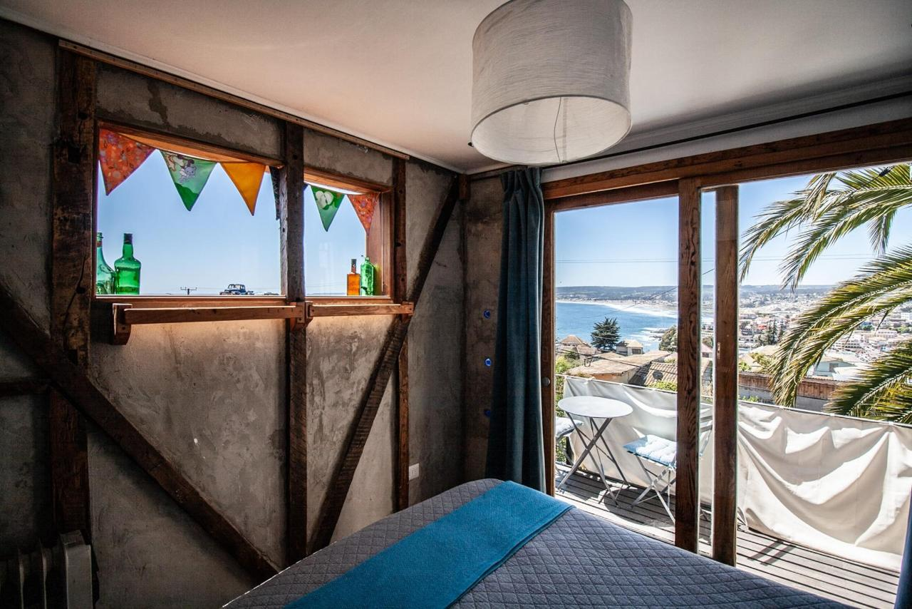 Dormitorio suite con vista al mar