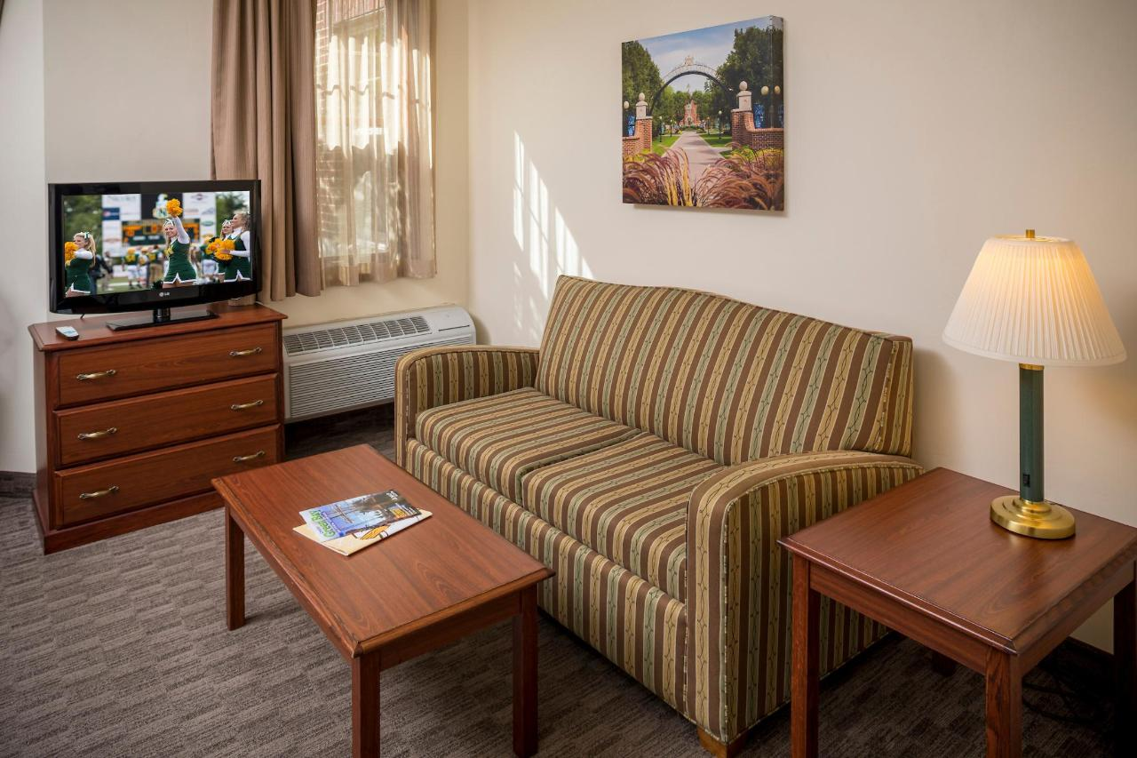 Kress Inn Queen Suite with Sofa Sleeper Sitting Area.JPG
